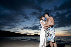 Couple of young lovers on the beach Stock Photo