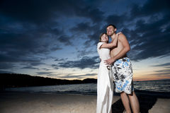 Couple of young lovers on the beach Royalty Free Stock Photography