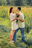 Couple of young lovers  hugging in the field Stock Images