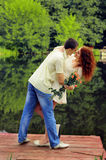 Couple of young lovers hugging on the pier Stock Photo
