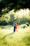 Couple of young lovers hugging under the vine branch Royalty Free Stock Photography