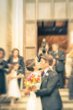Couple of young lovers kissing during wedding cerimony Stock Images