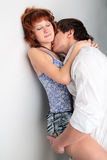 Couple young man and woman. Kissing on white background Stock Photo