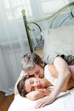 Couple, Young man and woman in bed. Royalty Free Stock Photo