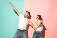 A couple of young man and woman dancing hip-hop at studio. Stock Images