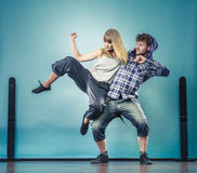 Couple of young man and woman dancing hip-hop Royalty Free Stock Photo