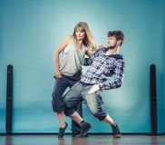 Couple of young man and woman dancing hip-hop Stock Image