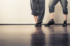 Couple of young man and woman dancing hip-hop Stock Photography