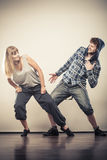 Couple of young man and woman dancing hip-hop Royalty Free Stock Image