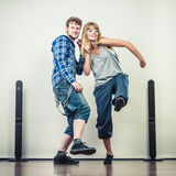 Couple of young man and woman dancing hip-hop Royalty Free Stock Images