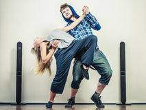 Couple of young man and woman dancing hip-hop Stock Images