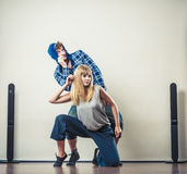 Couple of young man and woman dancing hip-hop Royalty Free Stock Photography