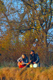 Couple of young musicians sitting in the ground Royalty Free Stock Photo