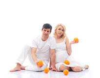 A couple of young parents with fresh oranges Stock Photos