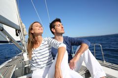 Couple of young people enjoying sailing cruise in the sun Royalty Free Stock Image