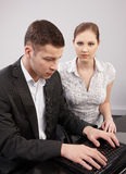 Couple of young people in the office working toget Royalty Free Stock Photo