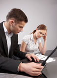 Couple of young people in the office working toget Royalty Free Stock Image
