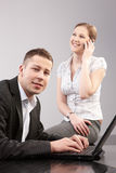 Couple of young people in the office working toget Royalty Free Stock Photography