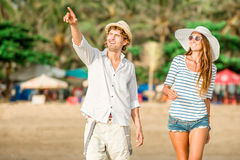 Couple young people walking along the beach on Royalty Free Stock Photography