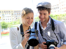 Couple of young photographers with reflex cameras Royalty Free Stock Photos
