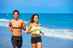 Couple young running in the beach in summer Royalty Free Stock Images