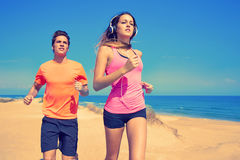 Couple young running in the beach in summer Stock Photos