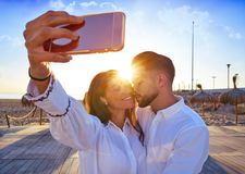 Couple young selfie photo in beach vacation. Couple young selfie photo in beach together vacation sunrise at Spain Royalty Free Stock Photo