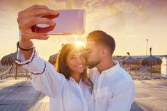 Couple young selfie photo in beach vacation. Couple young selfie photo in beach together vacation sunrise at Spain Royalty Free Stock Photos