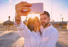 Couple young selfie photo in beach vacation. Couple young selfie photo in beach together vacation sunrise at Spain Stock Photography