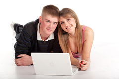 Couple young student with laptop Royalty Free Stock Photos