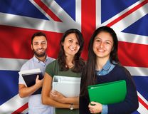 Young students over United Kingdom flag. Couple of young students with books over United Kingdom flag Royalty Free Stock Photos