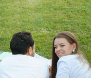 Couple of young students studying outside in the park Royalty Free Stock Photo
