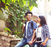 Couple of young travelers: walking around old town. Vacation, summer, holiday, tourism Stock Images