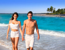 Couple young walking in a tropical Caribbean beach Stock Photos