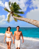 Couple young walking in a tropical Caribbean beach Royalty Free Stock Photography
