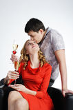 Couple of young woman and man drink champagne Royalty Free Stock Photos