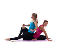 Couple young woman posing during stretch exercise Stock Photo
