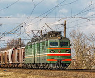 The coupled locomotive VL80-605 pulls freight cars of freight tr. Belarus, Minsk - 20.03.2017: Twin locomotive VL80-605 pulls freight cars of freight train Royalty Free Stock Photography