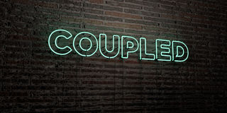 COUPLED -Realistic Neon Sign on Brick Wall background - 3D rendered royalty free stock image Stock Photos