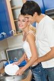 Couples à la cuisine Images libres de droits