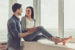 Couples à la maison Photo stock