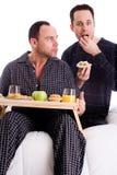 Couples à la maison dans le pyama Photo stock