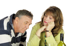 Couples âgés moyens avec affliction Photographie stock