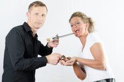 Couples échangeant l'argent contre le chocolat Photos libres de droits