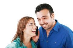 Couples écoutant quelque chose Images stock