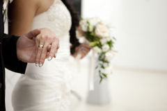 Couples. The Bride and groom hold each other's hands stock photo