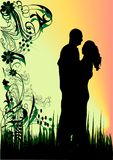 Couples. Silhouette of couples man and woman on flowers background Stock Image