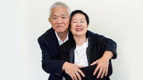 Couples aînés asiatiques heureux Succès dans les affaires et la vie, togher Images libres de droits
