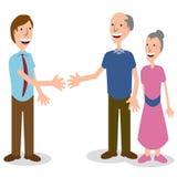 Couples aînés de salutation d'homme d'affaires Images stock