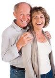 Couples aînés heureux souriant à l'appareil-photo Image stock